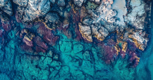 a top view of a rock formation near a body of water