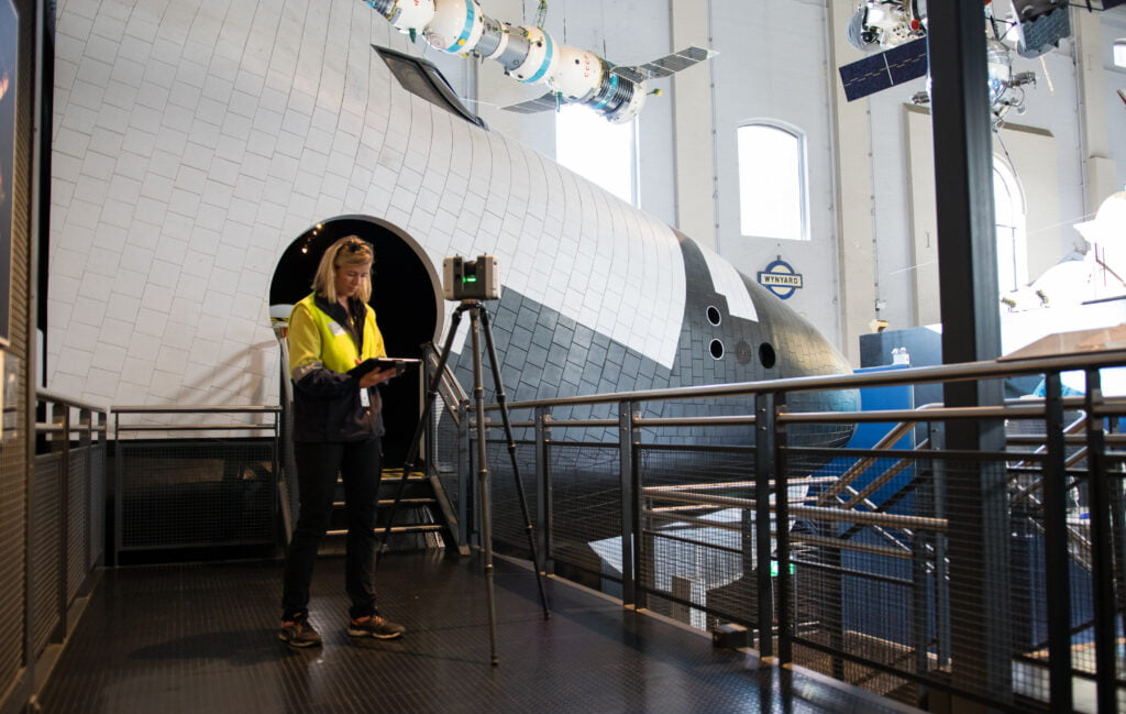 a female registered surveyor completing 3D scans in the Space Exhibition