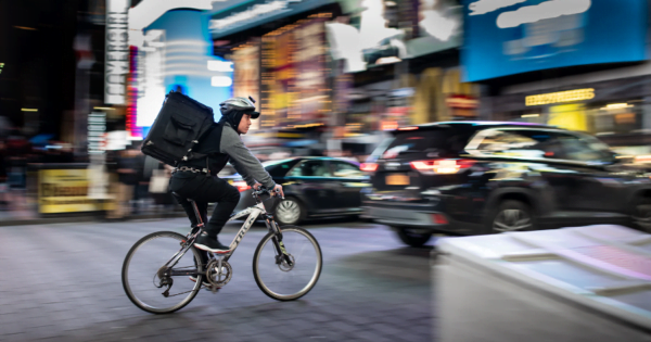 a food delivery man on his bike in the city