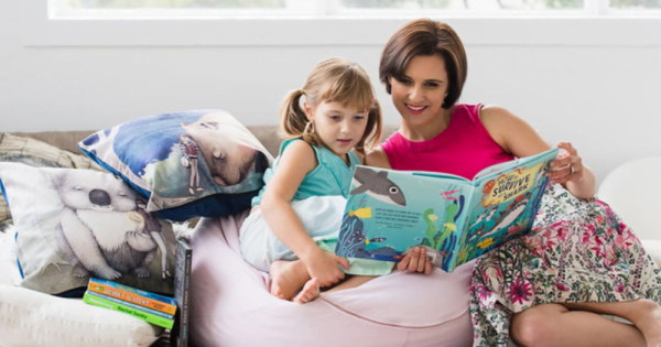 a mother reading ocean adventures to her little girl